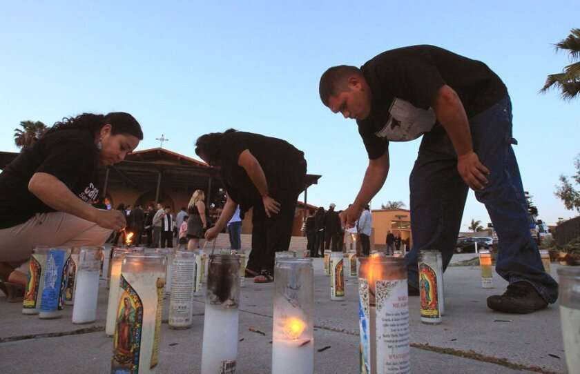 Participants in a vigil at Our Lady of Mount Carmel Catholic Church in San Ysidro light candles for the 43 students abducted last September 26 in Iguala, Mexico.