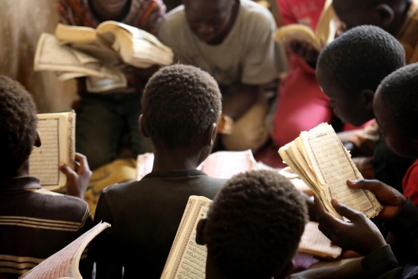 Talibes reading the Quran in Dakar.