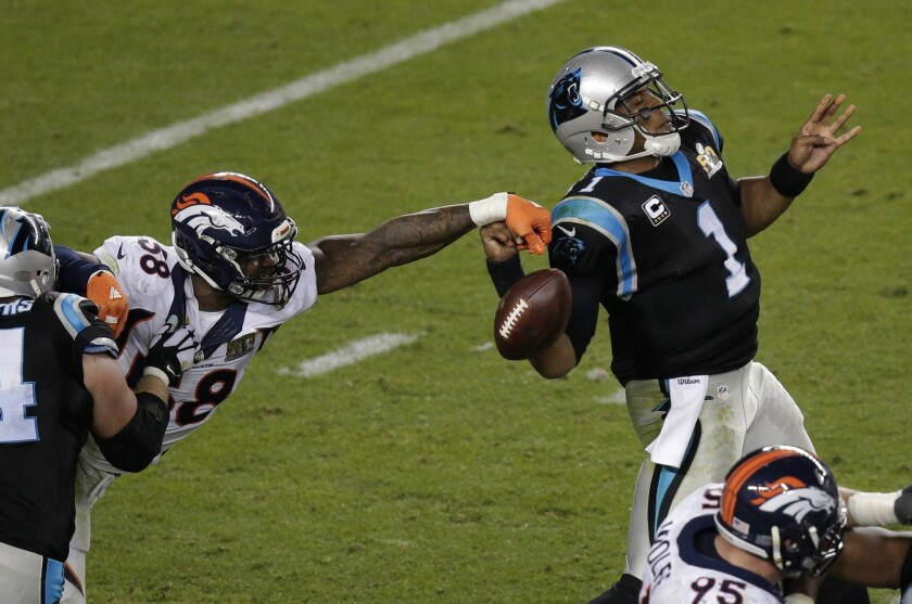 Denver's Von Miller strips the ball from Carolina's Cam Newton during Super Bowl 50.