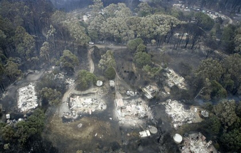 Small acreage is burned out in Kinglake, northeast of Melbourne, Australia, Sunday, Feb. 8, 2009. Towering flames have razed entire towns in southeastern Australia and burned fleeing residents in their cars as the death toll rose to 84, making it the country's deadliest fire disaster. At least 700 homes were destroyed in Saturday's inferno. (AP Photo/Rick Rycroft)
