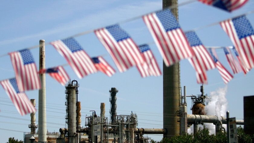 American flags fly near the Shell refinery in Martinez, Calif.