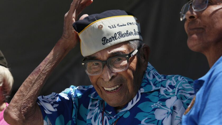 August 13, 2017 San Diego, CA. USA | Pearl Harbor Survivor Ray Chavez puts his cap back on after t