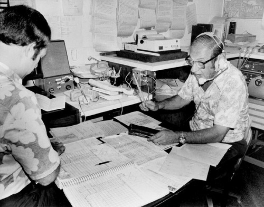 Les Keiter, right, seen in 1980 with assistant Al Elconin, was known for his radio re-creations of San Francisco Giants games for New York listeners in the first few years after the baseball team moved to California. He used bare information from wire reports and telephone calls and embellished the facts with sound effects, recorded crowd noise and imagination.