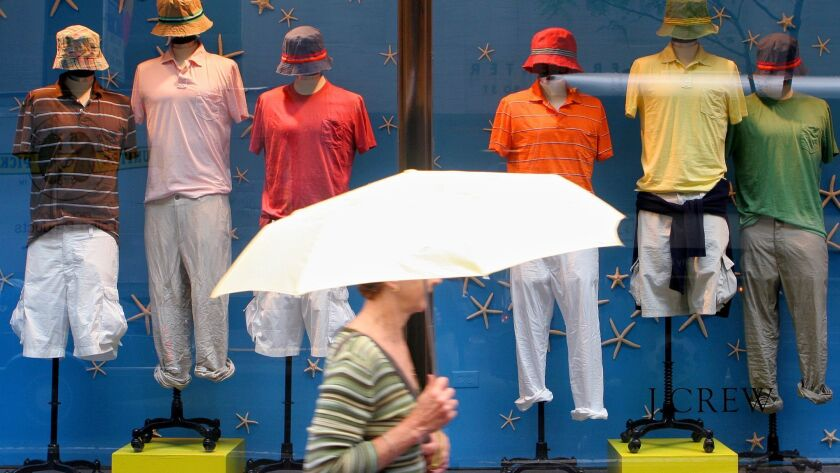 A woman passes a J.Crew store Monday, June 26, 2006 in New York. Shares of J. Crew Group Inc., the N