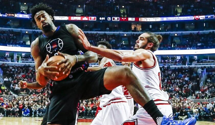 Clippers center DeAndre Jordan, left, grabs a rebound next to Bulls center Joakim Noah in the first half on Thursday.