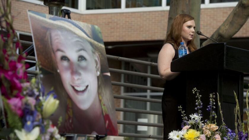 Ashley Fine speaks during a vigil for Mackenzie Lueck at the university in Salt Lake City on Monday,
