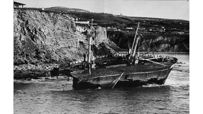 Jan. 18, 1964: The wreckage of the Greek freighter Dominator, gradually being torn apart by the surf