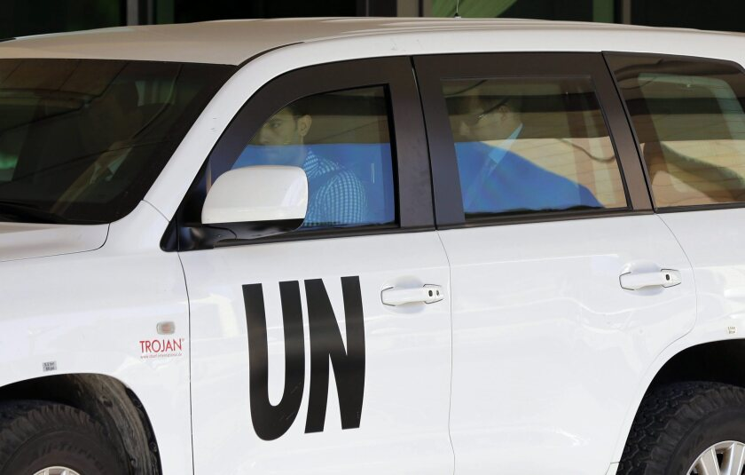 Members of the team of inspectors from The Hague-based Organization for the Prohibition of Chemical Weapons leave their hotel in Damascus, Syria, this month.