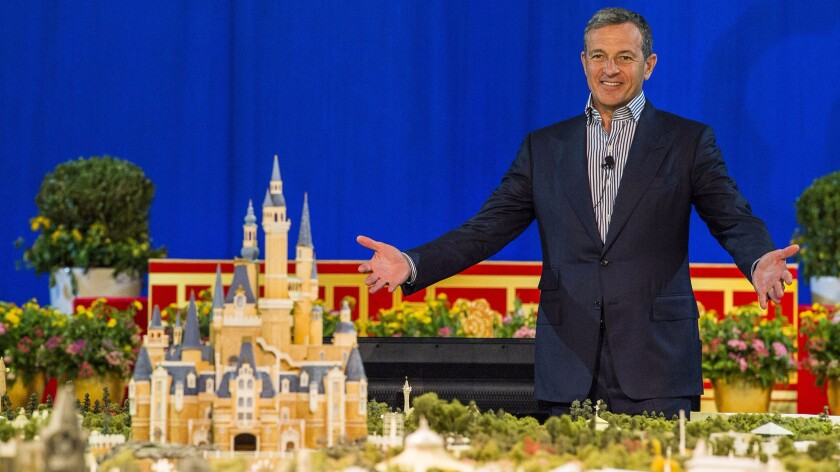 Walt Disney Co. Chairman and Chief Executive Robert Iger unveils a model of Shanghai Disneyland at a 2015 presentation in China.