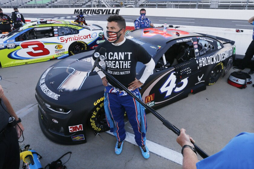 Driver Bubba Wallace is interviewed before a NASCAR Cup Series auto race Wednesday, June 10, 2020, in Martinsville, Va.