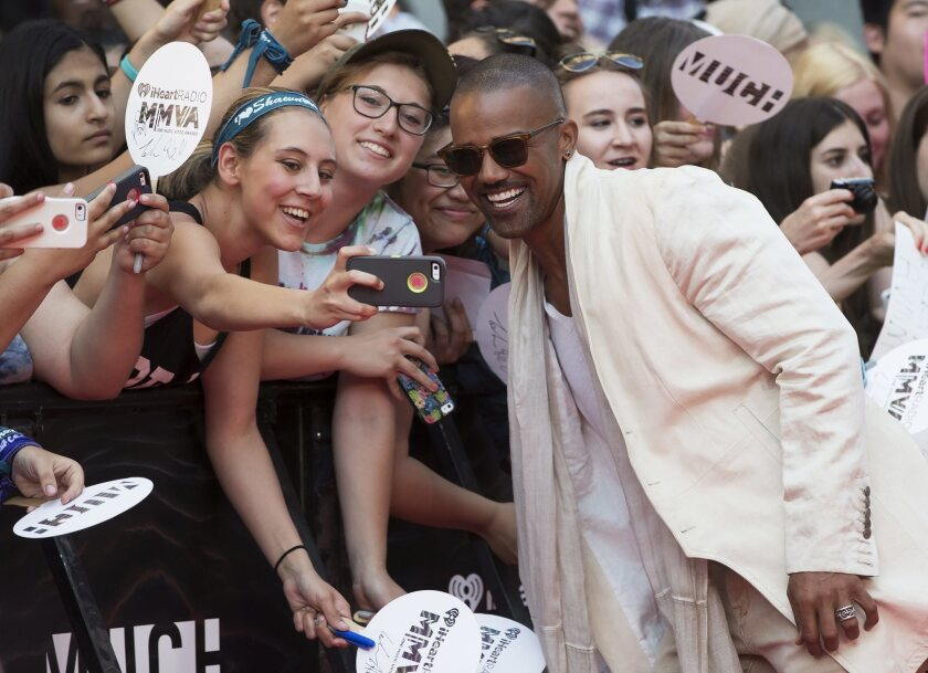 Shemar Moore poses for photographs on the red carpet during the Much Music Video Awards in Toronto in June.