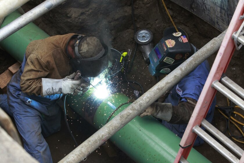 A crew works on a San Diego Gas & Electric gas pipeline.