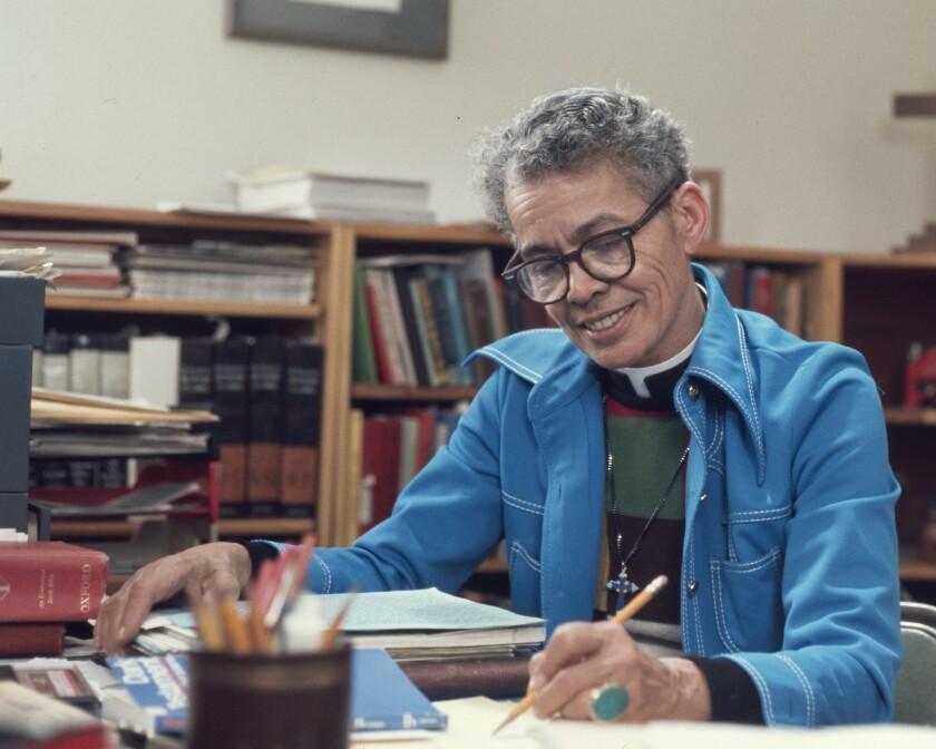 Pauli Murray at her office desk.