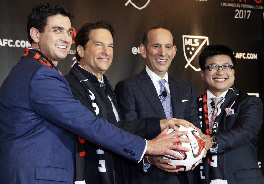 MLS Commissioner Dan Garber, second from right, joins (from left) team owners Tom Penn, Peter Guber and Henry Nguyen to announce the Los Angeles Football Club will join the league in 2017.