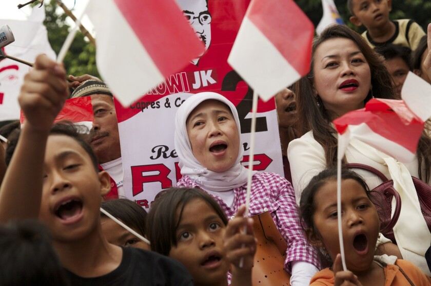 Supporters of Joko Widodo, the president-elect of Indonesia, cheer at his election victory rally in Jakarta on July 23.