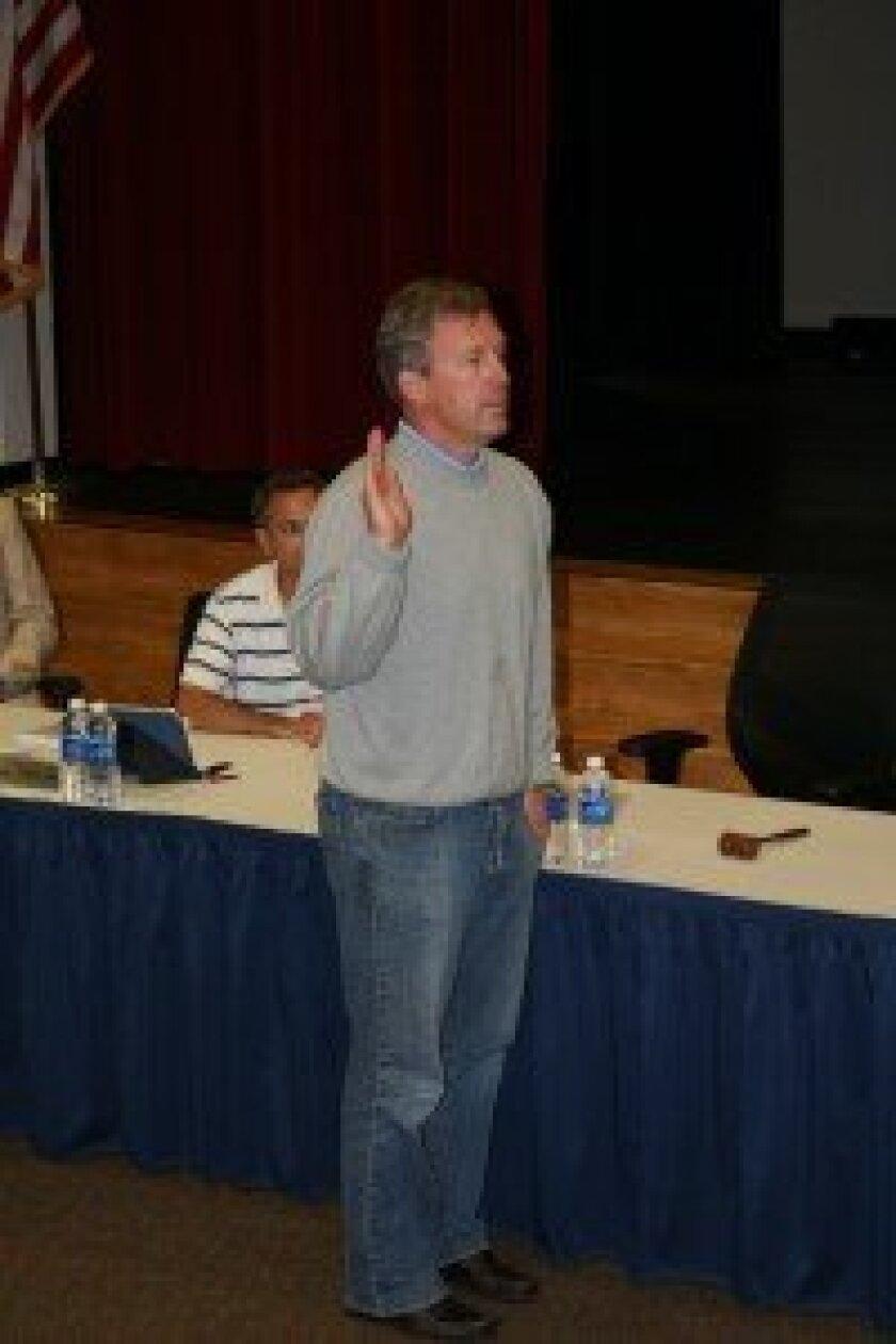 New board member Todd Buchner is sworn in at the Dec. 13 meeting. Photo/Karen Billing