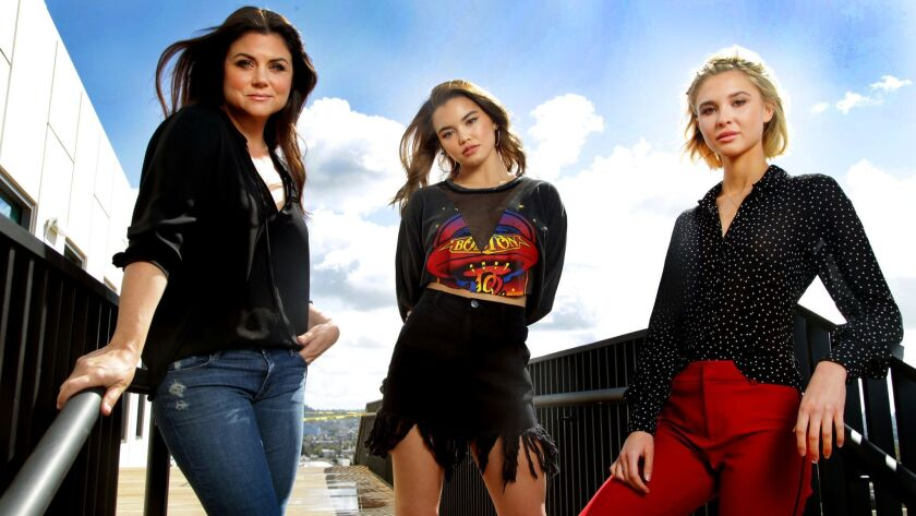 (L-R) Tiffani Thiessen, Paris Berelc and Isabel May star in the Netflix series 'Alexa & Katie.'