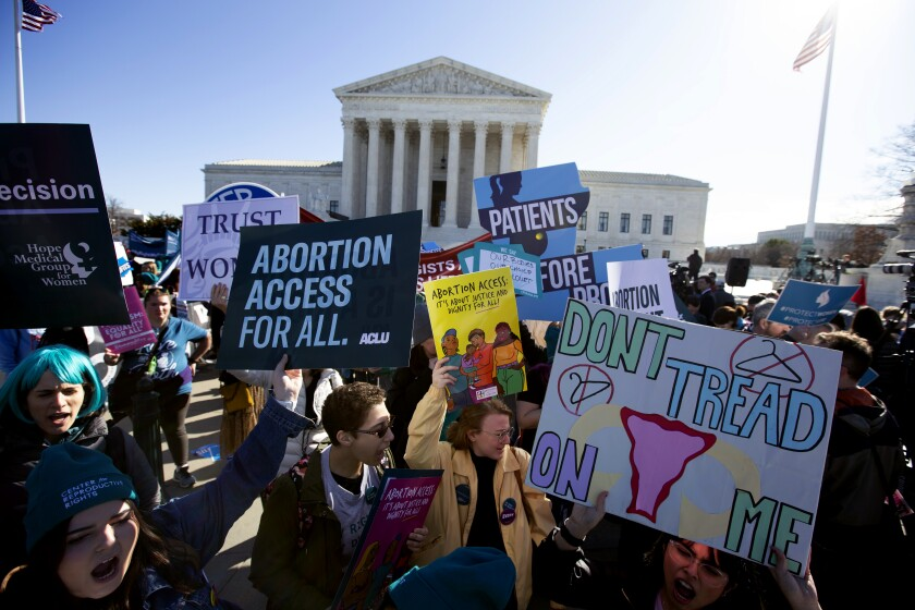 Abortion rights demonstrators and anti-abortion demonstrators rally outside the U.S. Supreme Court