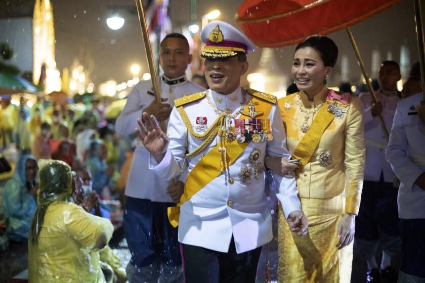 Thai King Maha Vajiralongkorn and Queen Suthida outside Bangkok's Grand Palace.