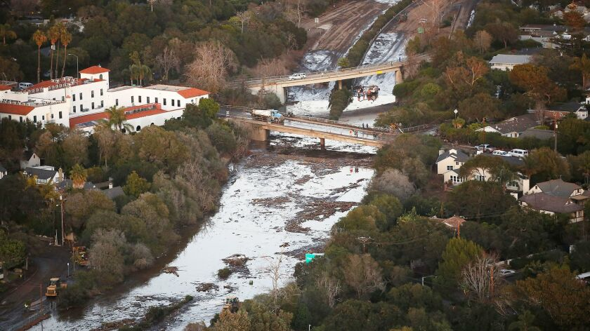 The 101 Freeway is closed on Jan. 11 as mud and debris clog the roadway at the Olive Mill Road overpass in Montecito.