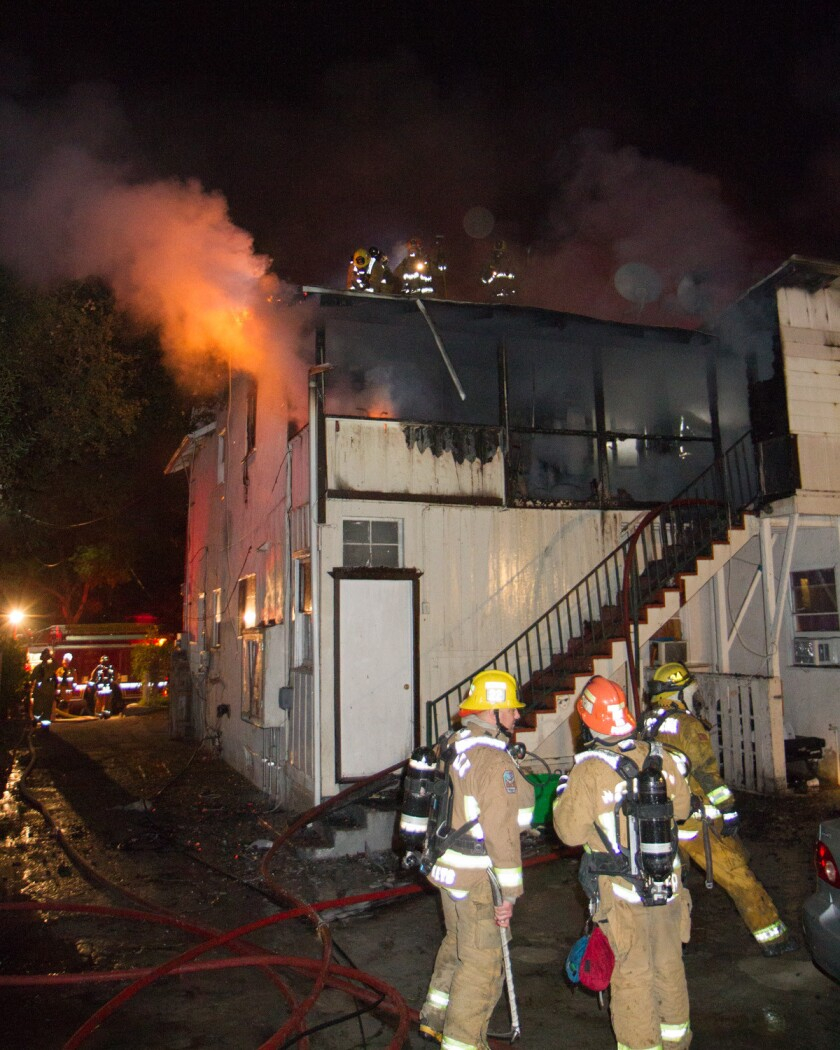 Pasadena Fire Department officials said careless smoking was the source of a fire that tore through a two-story apartment complex in Pasadena early Monday.