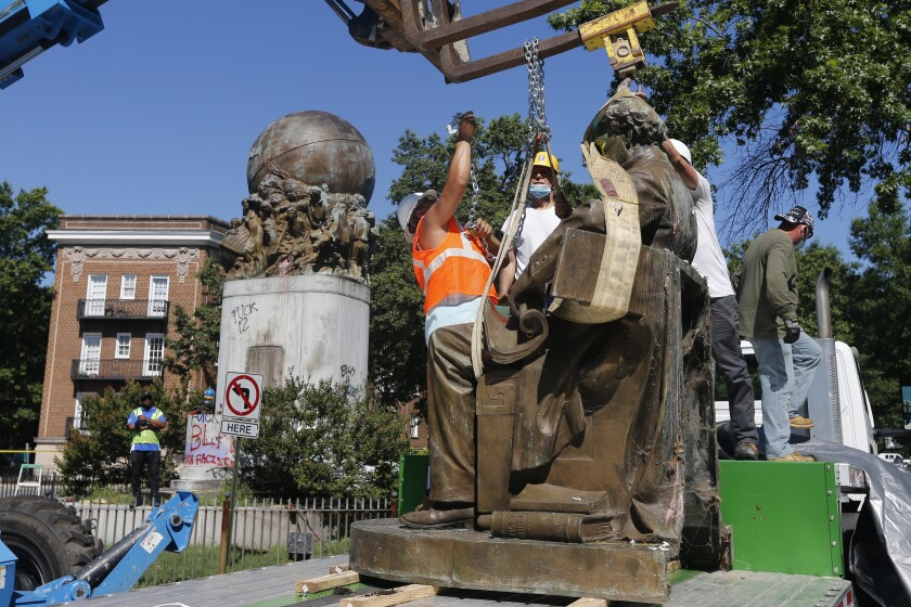 EDS NOTE: OBSCENITY - Workers remove the statue of Confederate Naval officer Matthew Fontaine Maury on Monument Avenue Thursday July 2, 2020, in Richmond, Va. Maury was better known for his work in oceanography and other sciences before the Civil War. His statue is the second removed since a new state law was enacted on July first. (AP Photo/Steve Helber)