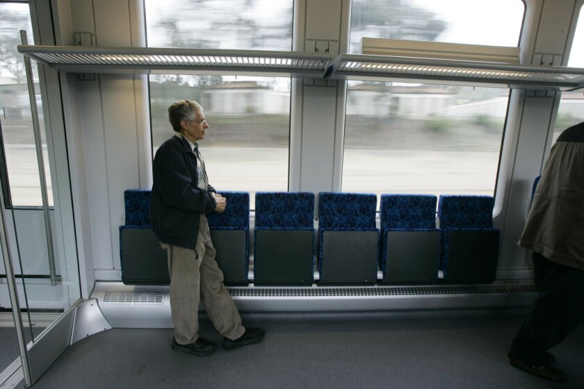 Richard Berk, the rail engineer who recently resigned from the North County Transit District, is pictured in April 2007 riding the Sprinter in Escondido before the rail system opened to the public.