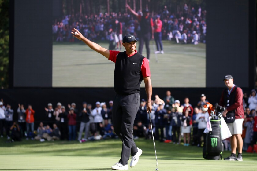 Tiger Woods celebrates after winning the Zozo Championship in Japan on Monday.