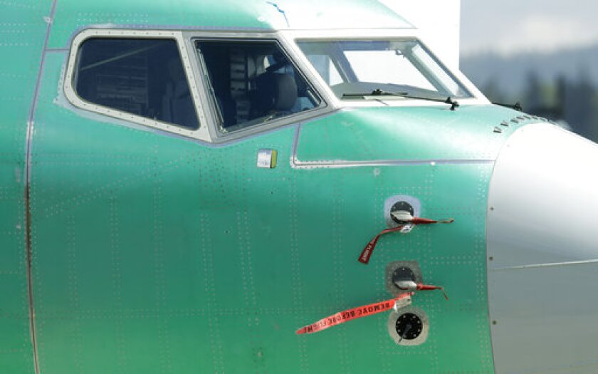 FILE - In this April 26, 2019, file photo caution flags are shown on flight sensors on a Boeing 737 MAX 8 airplane being built at Boeing's assembly facility in Renton, Wash. Investigators say many Federal Aviation Administration inspectors who worked on pilot-training standards for the grounded Boeing 737 Max and other planes were themselves unqualified and insufficiently trained. The U.S. Office of Special Counsel also says that the FAA gave Congress misleading answers when it asked about FAA employee training. (AP Photo/Ted S. Warren)