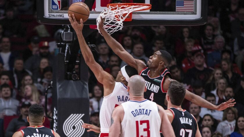 Portland Trail Blazers' Maurice Harkless (4) tries to defend a Los Angeles Clippers player during an