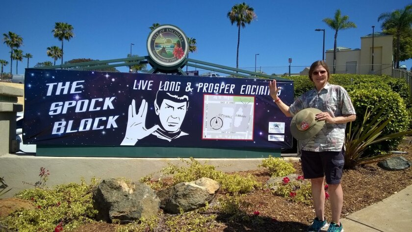 "Resident Kris Stewart poses in front of a sign celebrating ""Spock Block."" The event, a tribute to the late Leonard Nimoy, will be held March 22-26 at the Encinitas Civic Center and Encinitas Library."