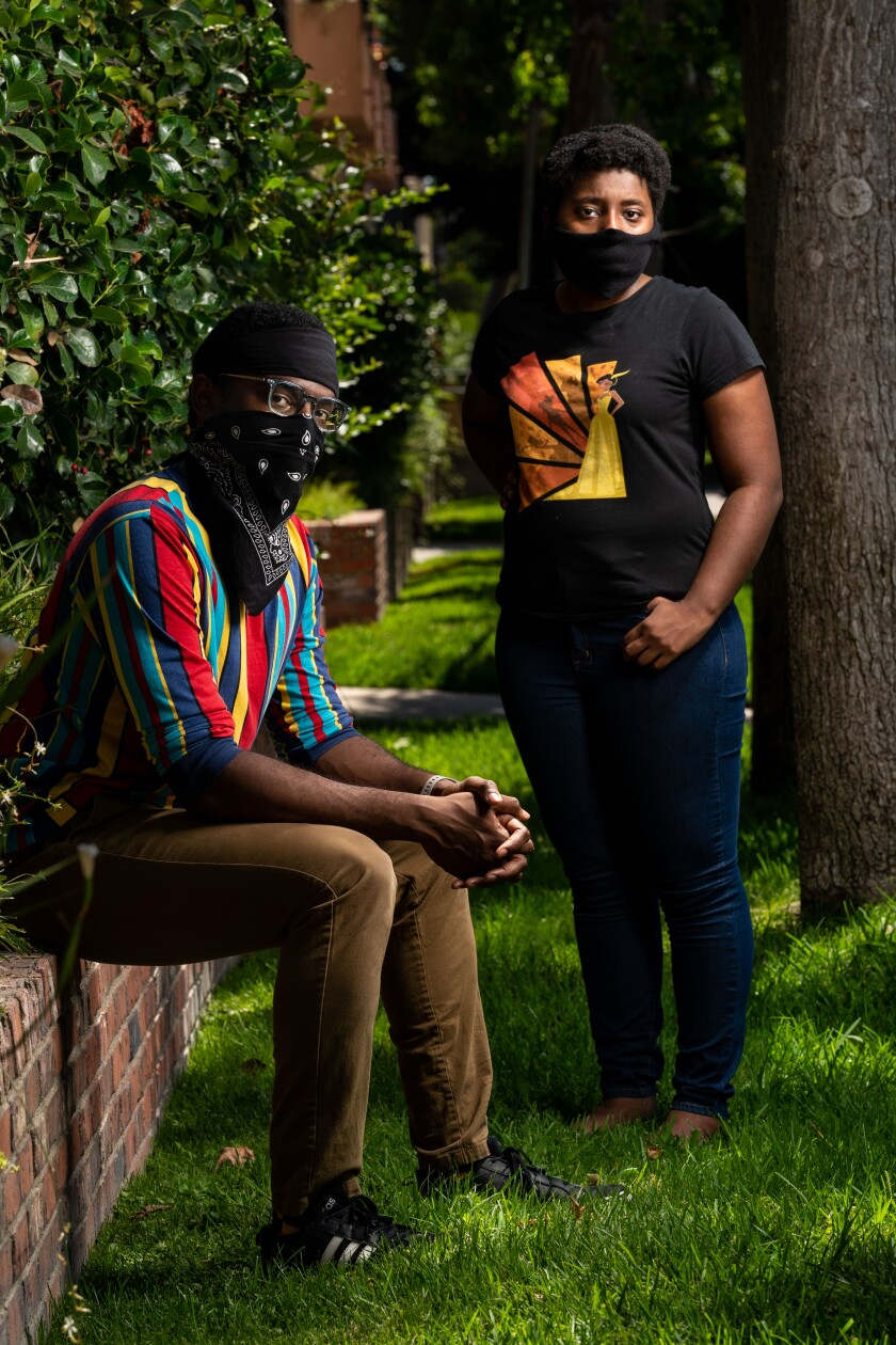 Waymond Singleton and Breana Williams, founders of Black N' Animated and hosts of its podcast, pose in masks.