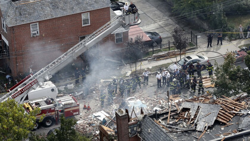 Emergency service personnel work at the scene of a house explosion in the Bronx borough of New York. Authorities believe that the house was the site of an indoor marijuana growing operation.