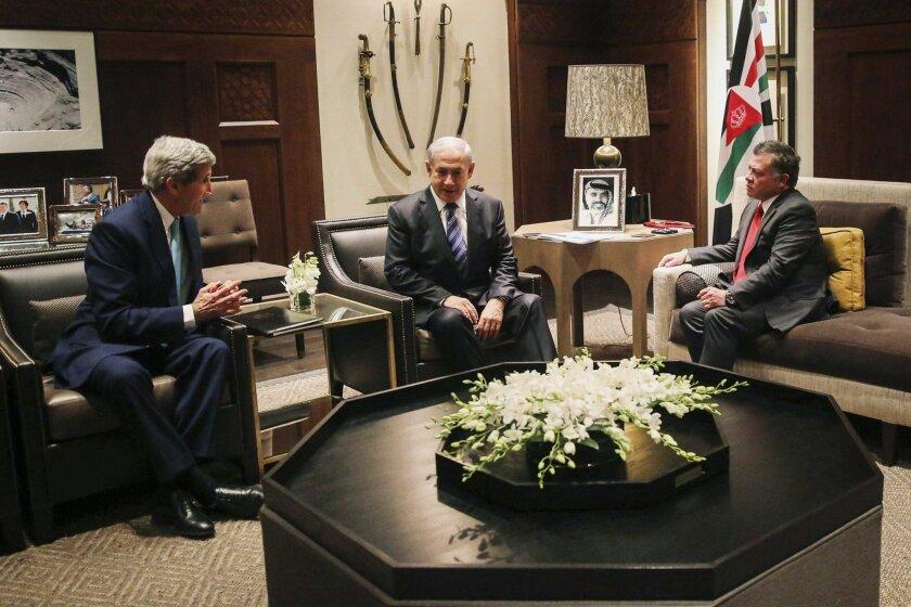 This 2014 photo shows U.S. Secretary of State John Kerry, Israeli Prime Minister Benjamin Netanyahu and Jordanian King Abdullah II meeting in Amman, Jordan, also to discuss ways to restore unrest in Jerusalem.