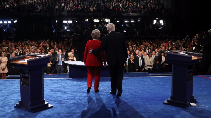 Hillary Clinton and Donald Trump greet the audience at the end of the first presidential debate at Hofstra University in Hempstead, New York on Sept. 26.
