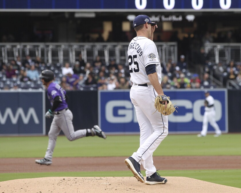 Padres pitcher Nick Margevicius stands on the mound as the Rockies' Nolan Arenado rounds the bases following his two-run homer in the first inning Tuesday.
