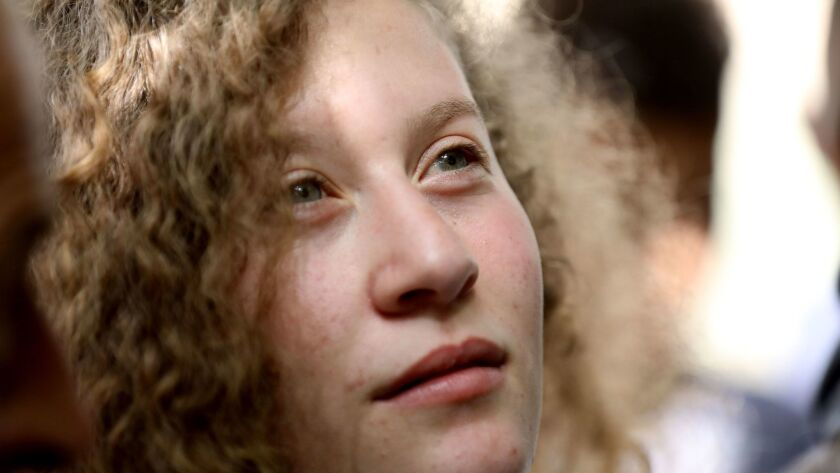 Ahed Tamimi, a 17-year-old Palestinian campaigner against Israel's occupation, is shown after arriving at her village, Nabi Saleh, near the West Bank town of Ramallah, on Sunday.