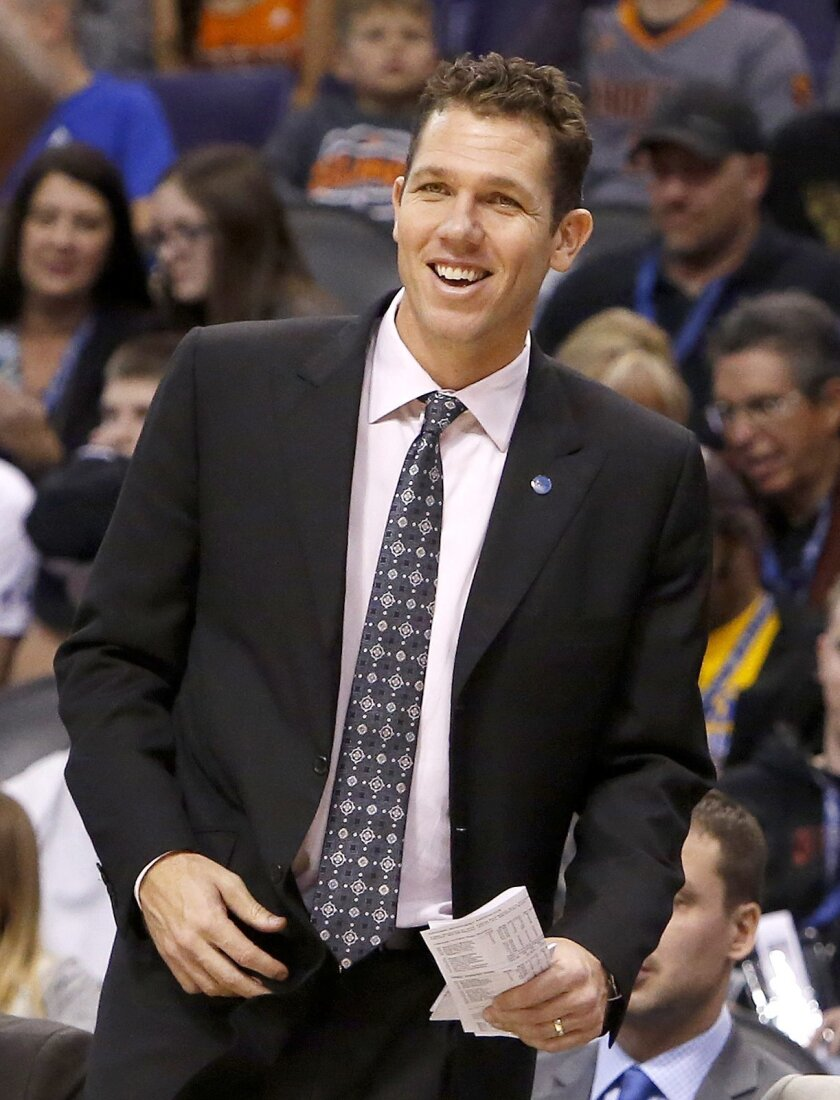 FILE - In this Nov. 27, 2015, file photo, Golden State Warriors interim head coach Luke Walton smiles in the first quarter during an NBA basketball game against the Phoenix Suns, in Phoenix. Walton has the Warriors off  to record start even if he doesn't get official credit for it. (AP Photo/Rick S