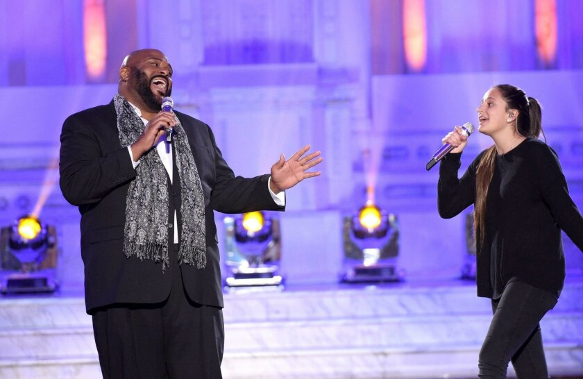 "Avalon Young of San Diego (right) performs with ""American Idol"" Season 2 winner Ruben Studdard during competition this week."