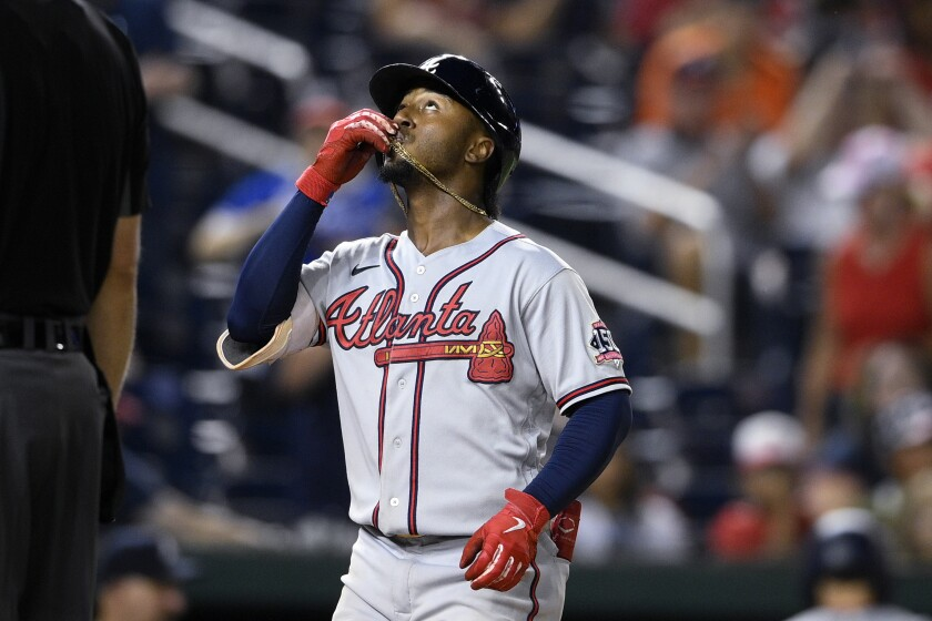 Atlanta Braves' Ozzie Albies looks skyward after his home run during the sixth inning of the team's baseball game against the Washington Nationals on Friday, Aug. 13, 2021, in Washington. The Braves won 4-2. (AP Photo/Nick Wass)