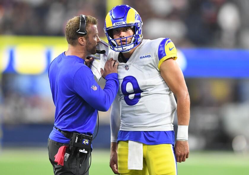 Rams head coach Sean McVay conveys a play to quarterback Matthew Stafford.