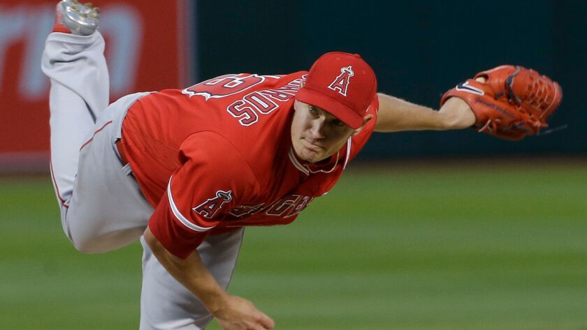 Los Angeles Angels pitcher Garrett Richards (43) throws against the Oakland Athletics during the fir