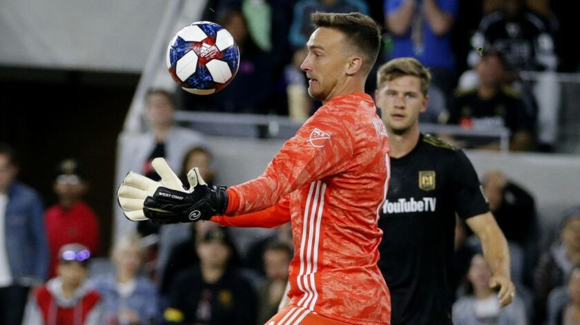 Los Angeles FC goalkeeper Tyler Miller (1) makes a save against Montreal Impact midfielder Shamit Sh