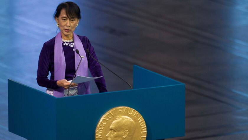In this June 16, 2012, file photo, Myanmar's Aung San Suu Kyi speaks during the Nobel Peace Prize le