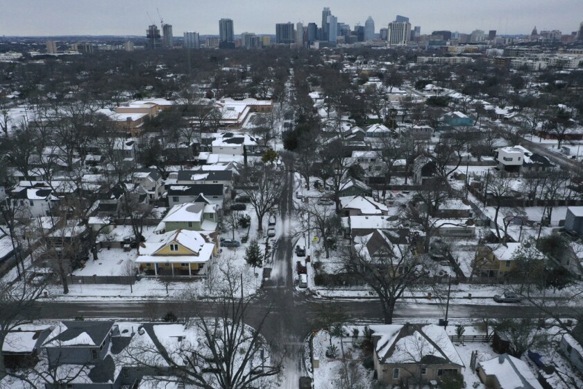Snow covers a neighborhood