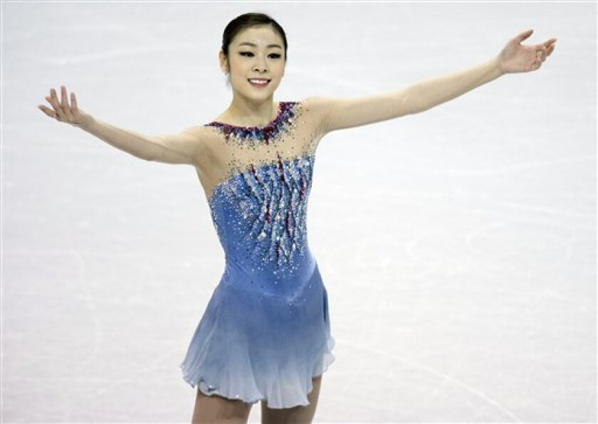 Kim Yu-na, from South Korea, smiles after her routine in the ladies short program at the World Figure Skating Championships Thursday, March 14, 2013, in London, Ontario. (AP Photo/The Canadian Press, Frank Gunn)