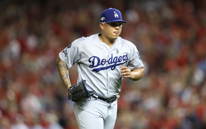 Dodgers pitcher Julio Urias jogs off the mound during Game 4 of the National League Division Series against the Washington Nationals on Oct. 7.
