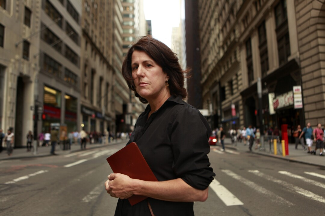 Geraldine Baum holds a diary while standing on a New York street