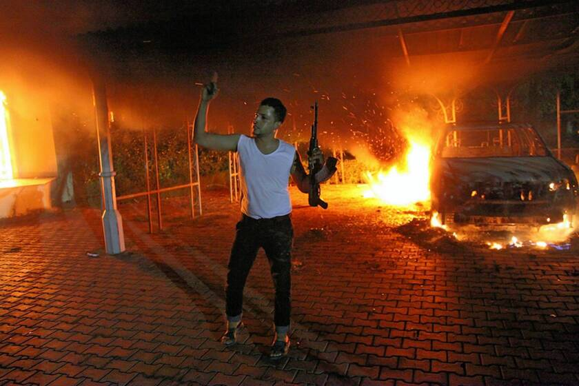 A man brandishes his weapon at the U.S. mission in Benghazi, Libya, the night it came under attack by Islamist militants.