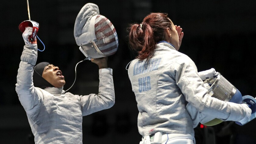 American fencer Ibtihaj Muhammad reacts after defeating Olena Kravatska of the Ukraine during a first-round match in the women's individual sabre competition on Monday.